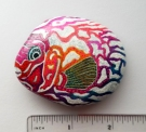 """Tropical Fish"" on river rock"