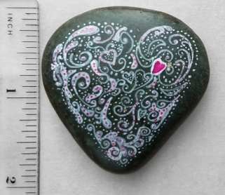 Heart on river rock